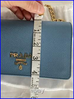 PRADA genuine Textured-leather shoulder bag blue gold chain from net-a-porter