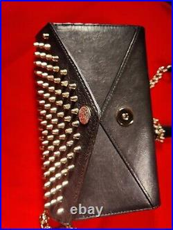 Studded wallet on chain by Rebecca Minkoff. Genuine leather for charm woman
